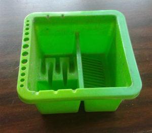 brush storage bin